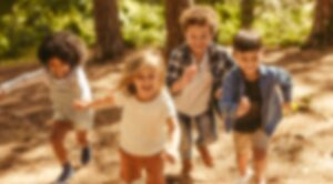 what a child with myopia sees - blurry children running at a distance