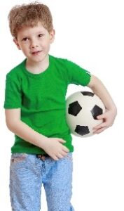 boy in green shirt carrying a soccer ball